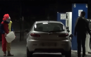 Killer Clown - Screenshot from a video of the clown pouring fake petrol around a victim's car